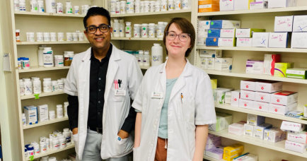 three pharmacist posing and smiling